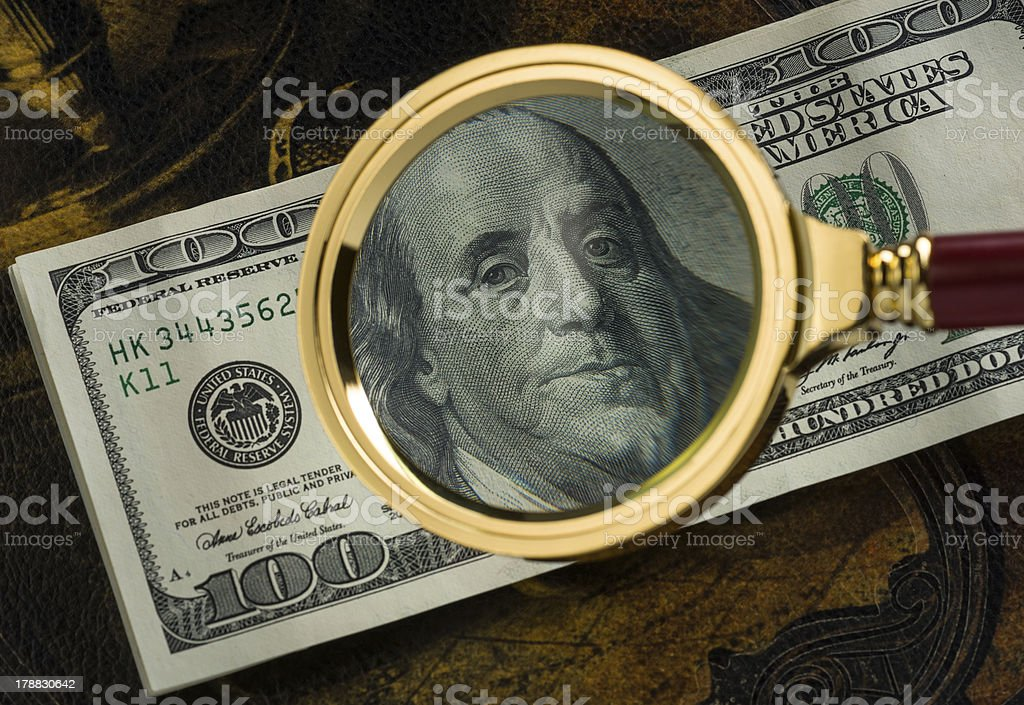 Usa dollars viewed through a magnifying glass royalty-free stock photo