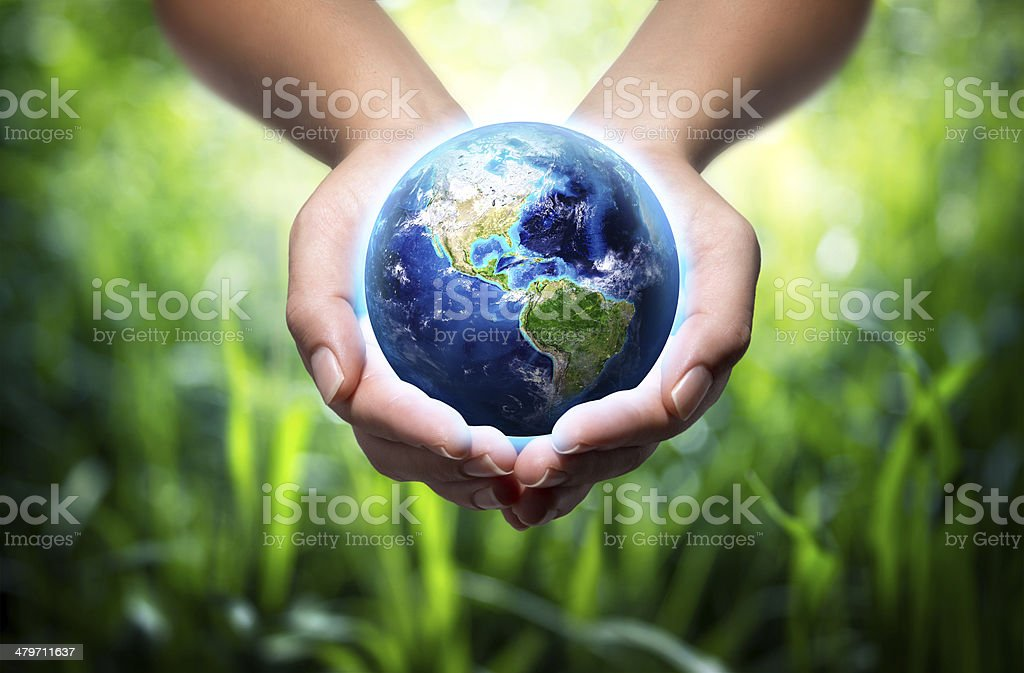 Usa in globe in hands  - Elements furnished by NASA stock photo