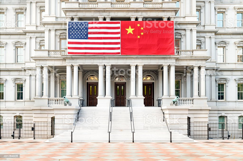 USA/Chinese Flag -  Old Exective Office Building, Washington, D.C. stock photo