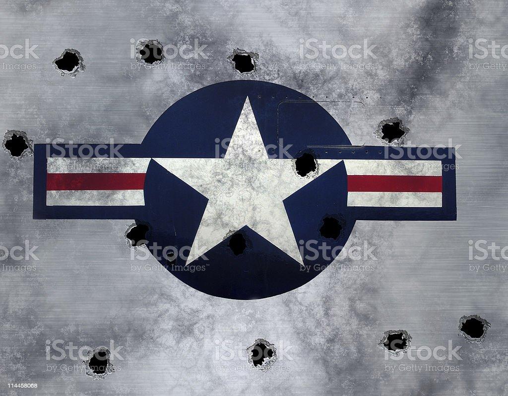 usaf roundel on grunge metal with bulletholes stock photo
