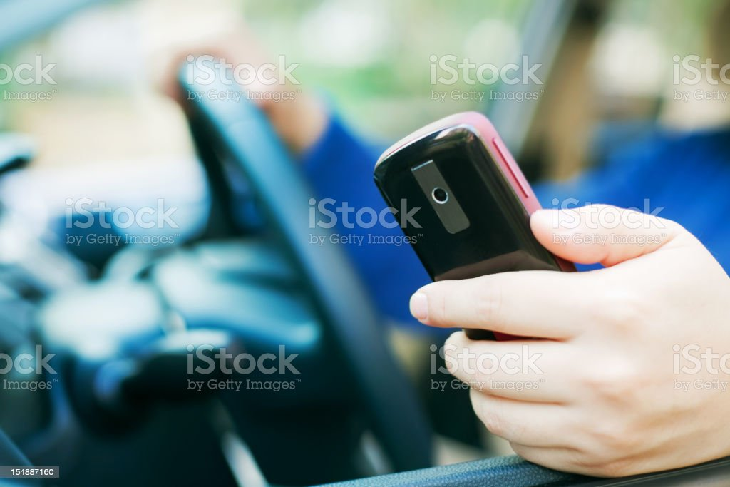 Use cellphone when driving stock photo
