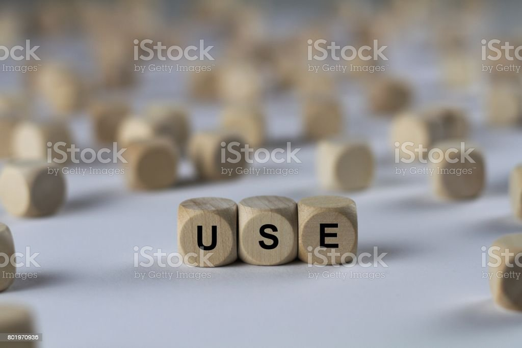 use - cube with letters, sign with wooden cubes stock photo