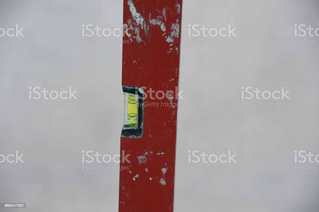 Use of a leveler IN building site stock photo
