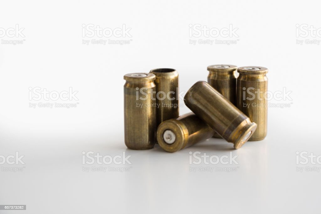 Used 9mm bullet casings on white background stock photo