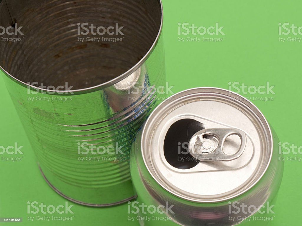 Used aluminum and food can on green background. royalty-free stock photo