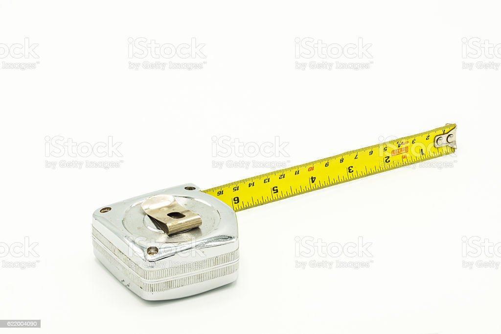 Used and old measuring tape stock photo