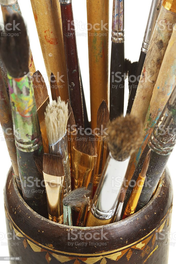 used artistic paintbrushes in wooden cup closed up royalty-free stock photo