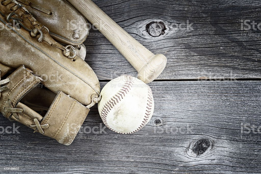 Used Baseball equipment on rustic wood stock photo