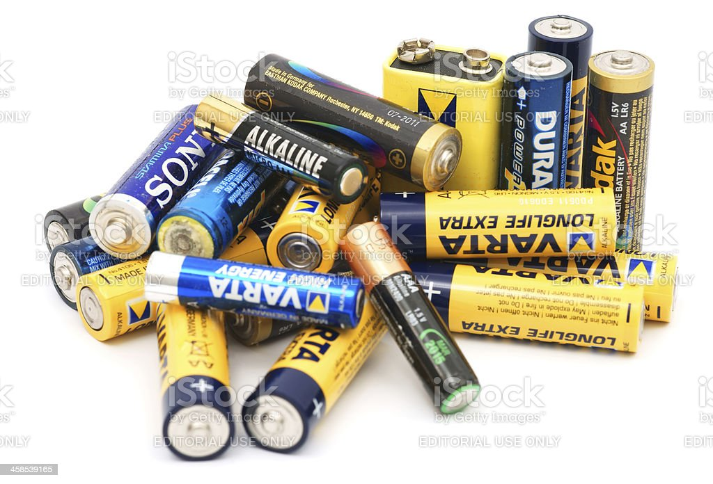 Used batteries pile isolated on white stock photo