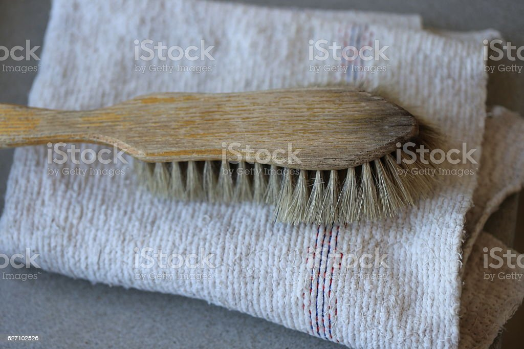 Used Brush on a Folded Floor Cloth. stock photo