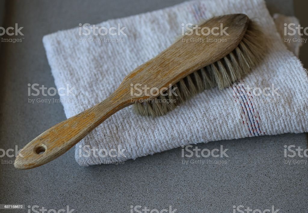 Used Brush on a Folded Floor Cloth stock photo