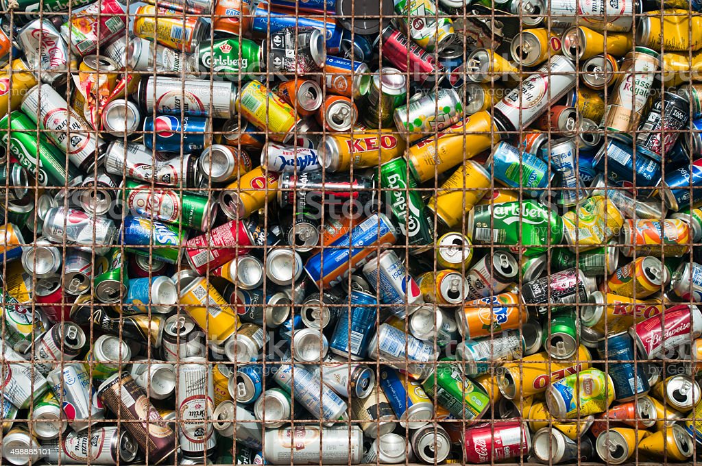 used cans in metal crate stock photo