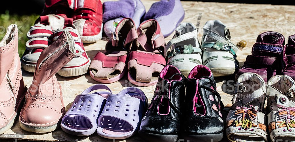 used child and baby shoes for reusing at flea market stock photo