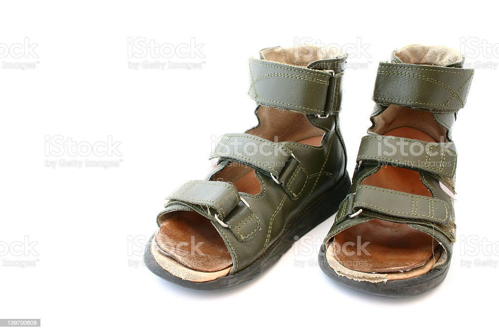 used children's orthopaedic sandals on white background royalty-free stock photo