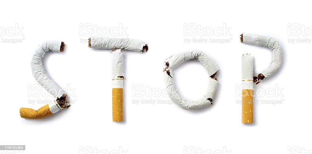 Used cigarettes shaped together to spell STOP for smoking stock photo