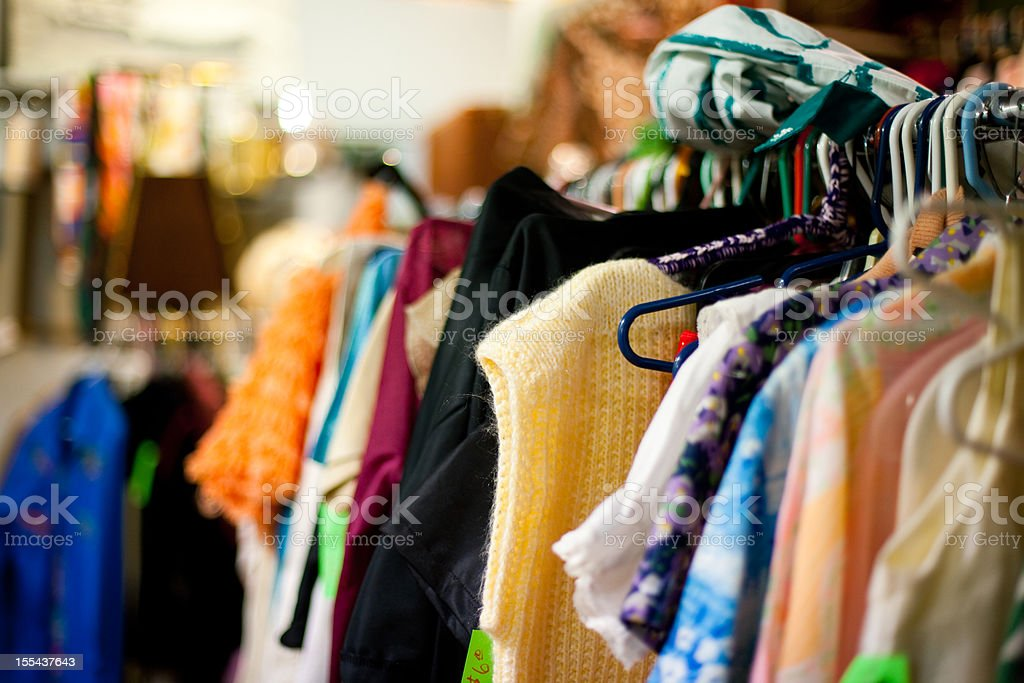 A used clothing rack at a thrift store royalty-free stock photo