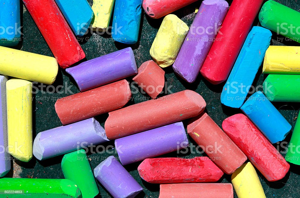 Used colored chalks in a box stock photo