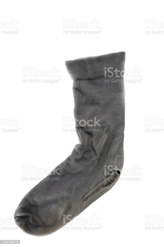 used dirty sock on a white background stock photo