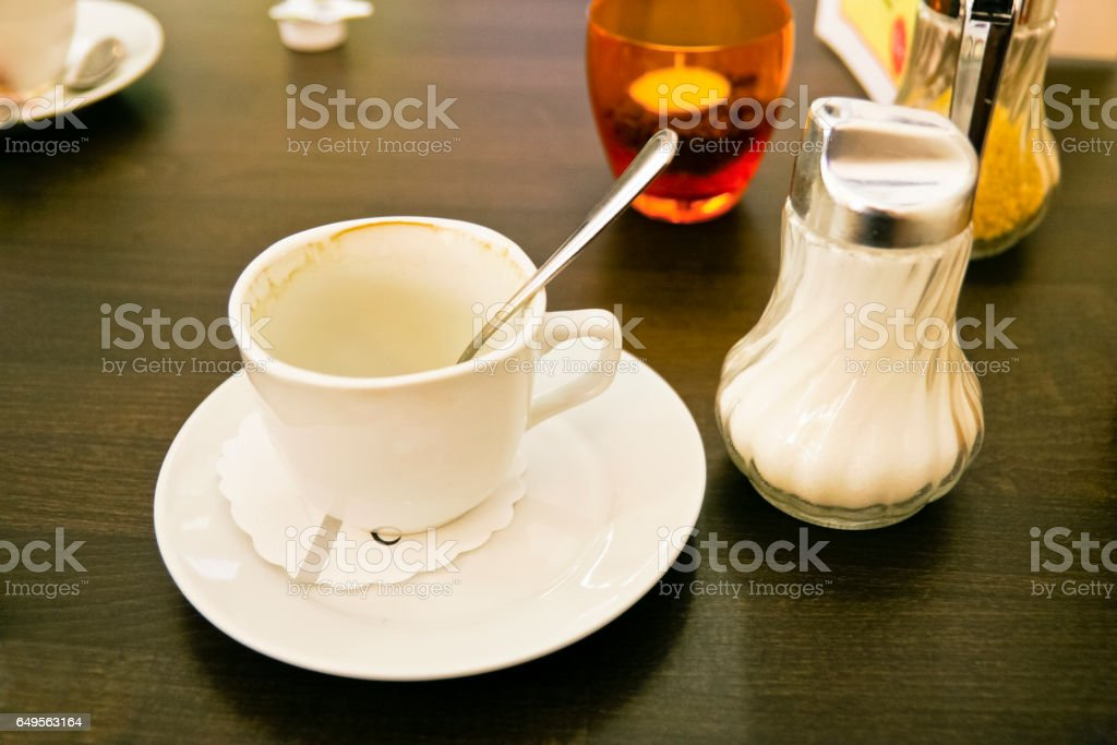 Used empty coffee cup stock photo
