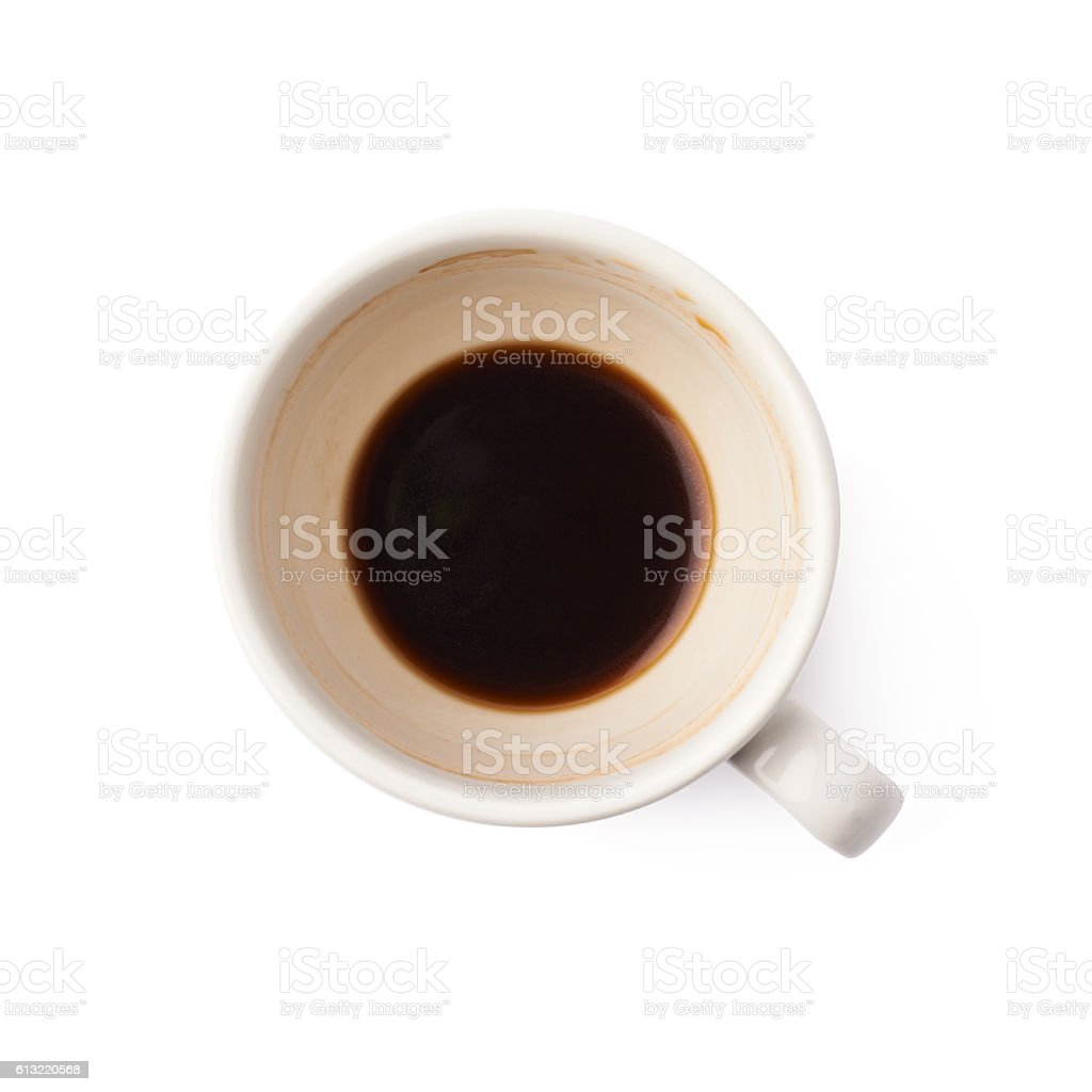 Used empty cup of coffee isolated stock photo