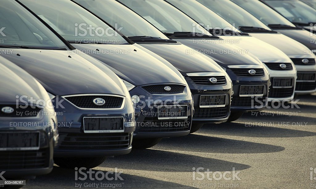 Used Ford vehicles on parking deck of a Ford Dealership stock photo