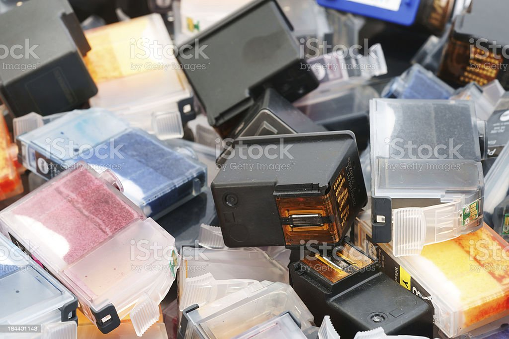 Used ink cartridges ready for recycling stock photo