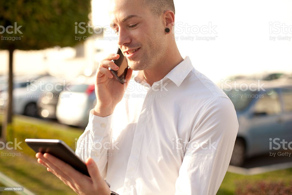 used mobile phones and digital tablet stock photo