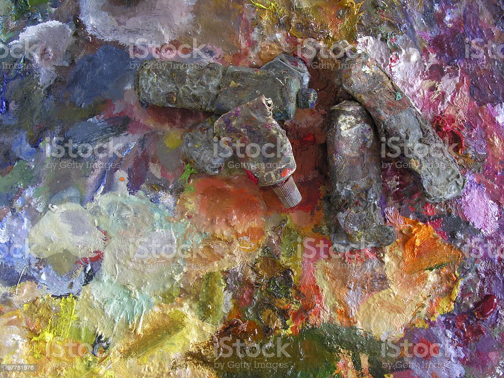 used oil-paint tubes on palette royalty-free stock photo