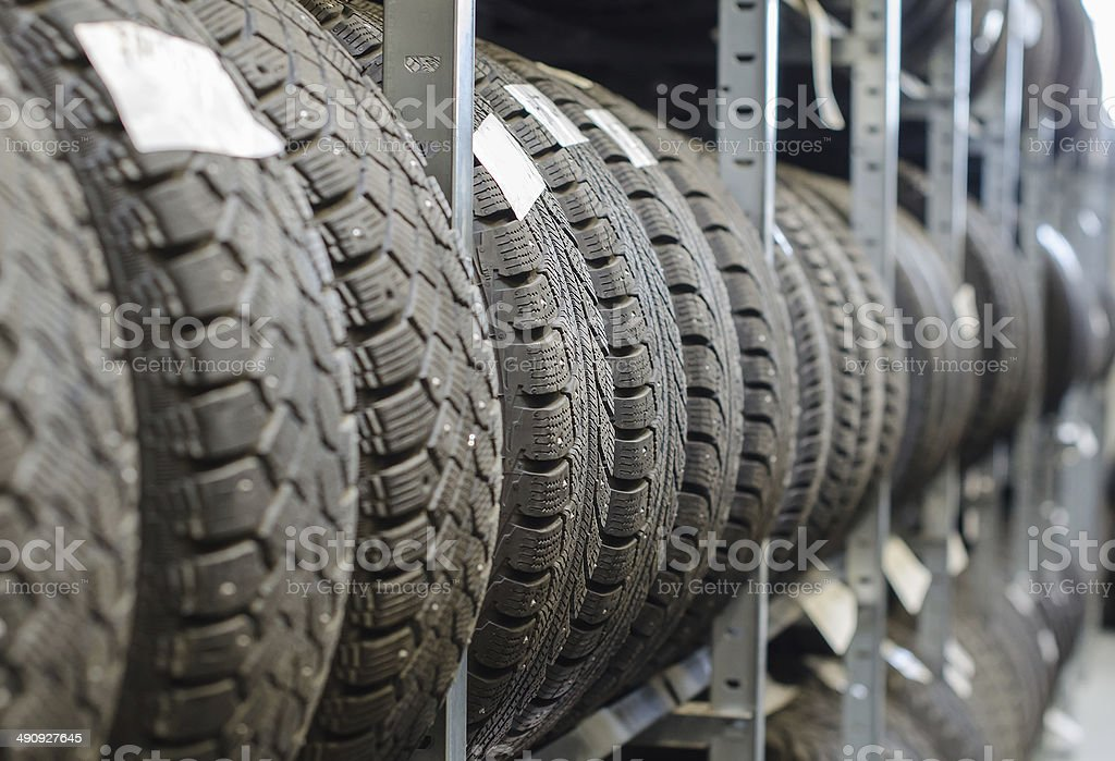 Used old car tires at warehouse. royalty-free stock photo