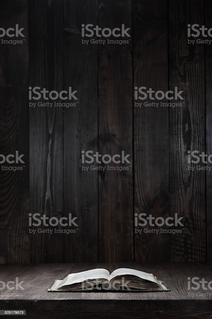 used open book on wooden table stock photo