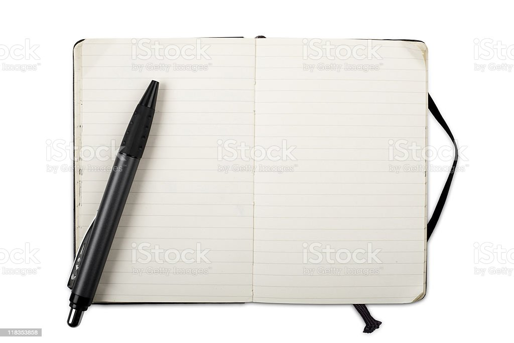 Used open notebook with ballpoint - isolated on white royalty-free stock photo