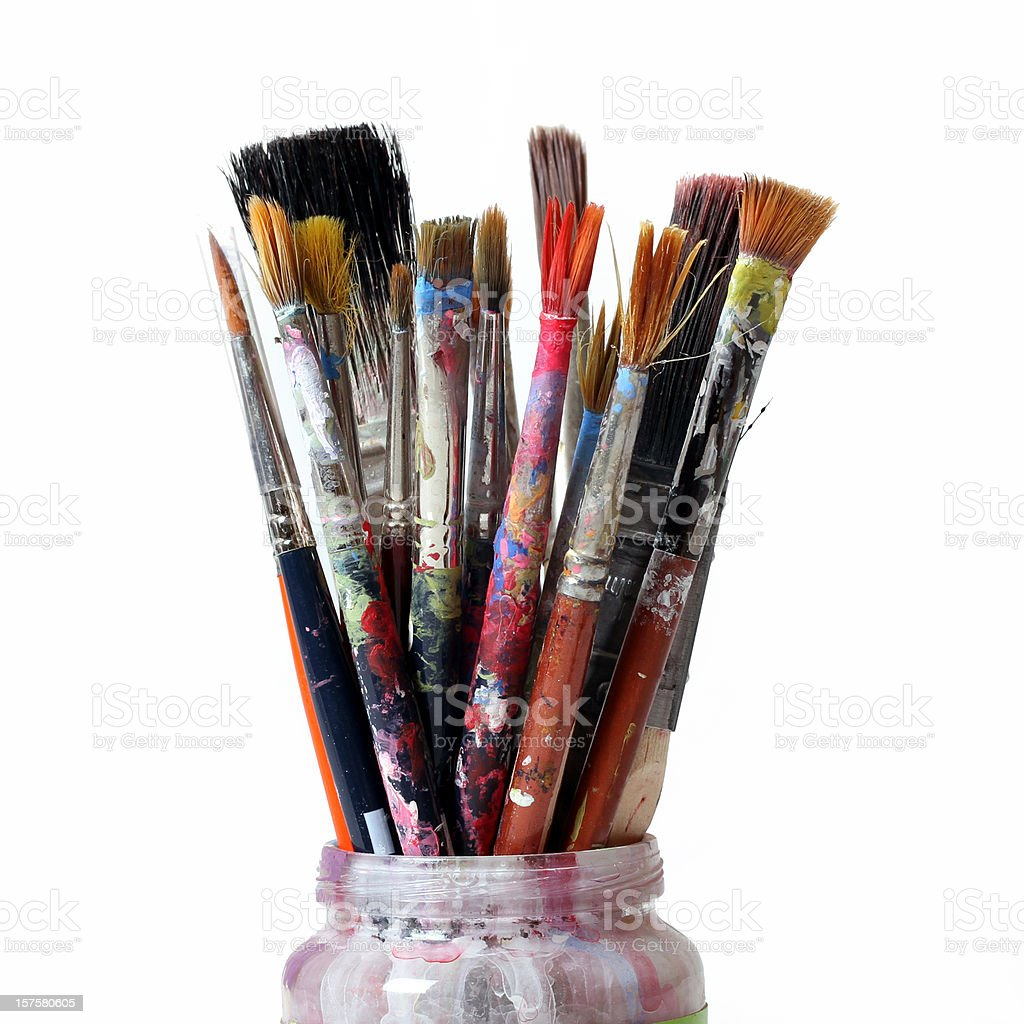 Used paintbrushes of various sizes in a jar stock photo