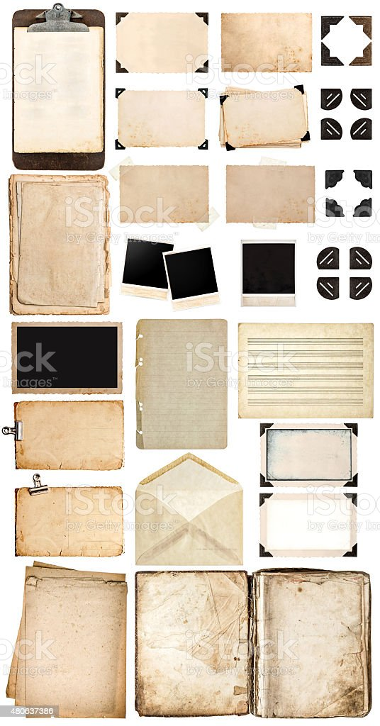 Used paper sheets, book, vintage photo frames and corners. stock photo