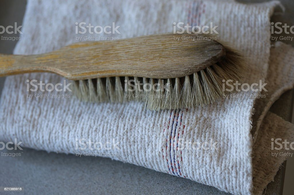 Used Scrub Brush on a Folded Floor Cloth. stock photo