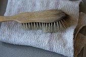 Used Scrub Brush on a Folded Floor Cloth.