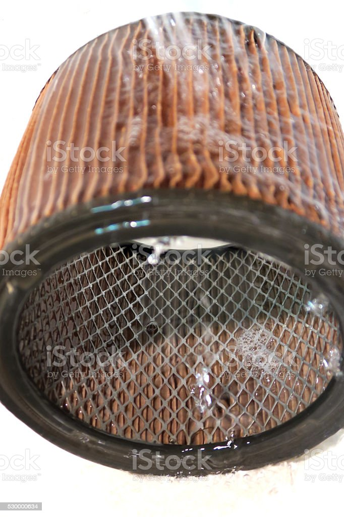 Used Shop Vacuum Filter cleaned with running tap water stock photo