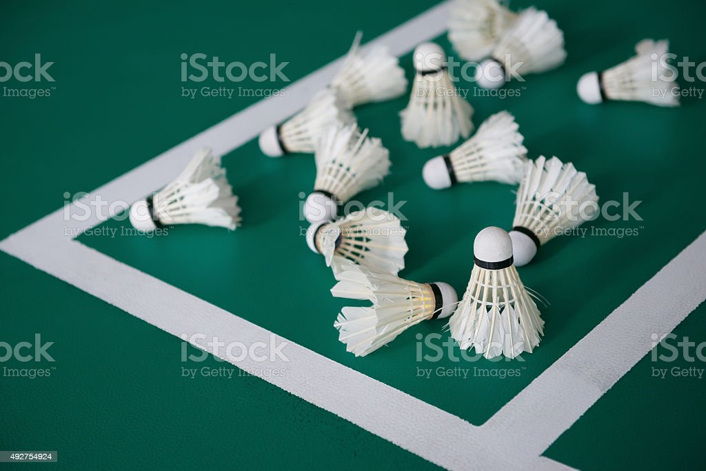 used shuttlecocks inside the edge of a badminton courts stock photo