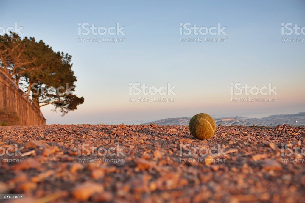 Used Tennis Ball on Ground stock photo