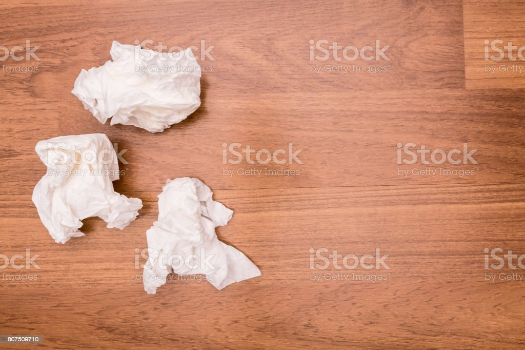 Used Tissue paper that Wiped the semen was left on the floor beside the bed. stock photo