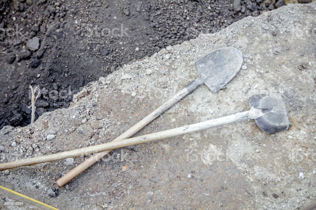 Used tools for earthworks are left over for a time off stock photo