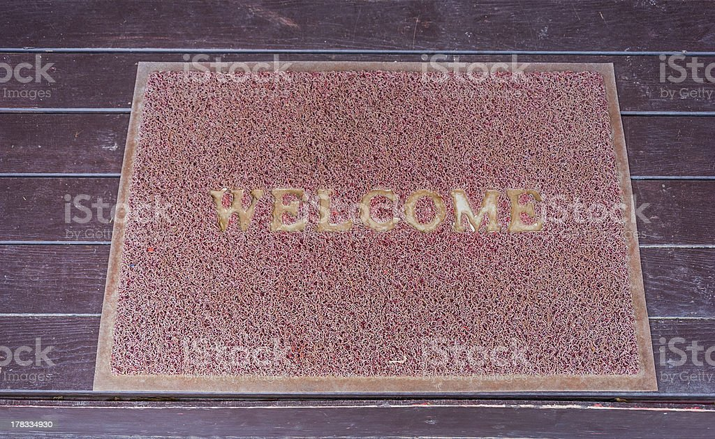 Used welcome carpet on the floor royalty-free stock photo