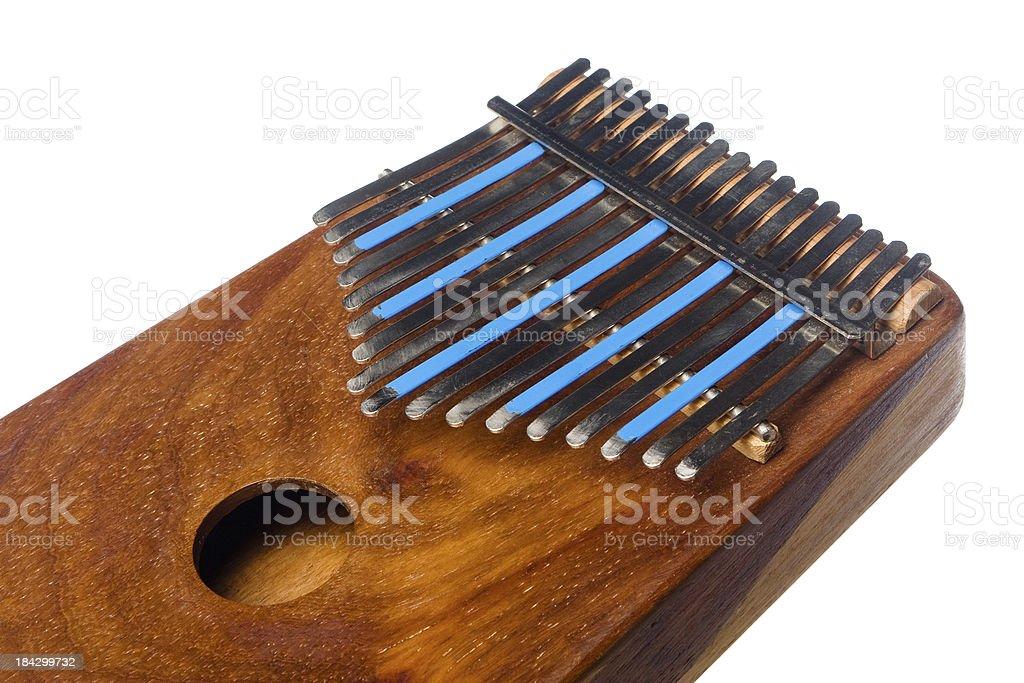 Used wooden Kalimba (Marimbula) thumb piano on white stock photo
