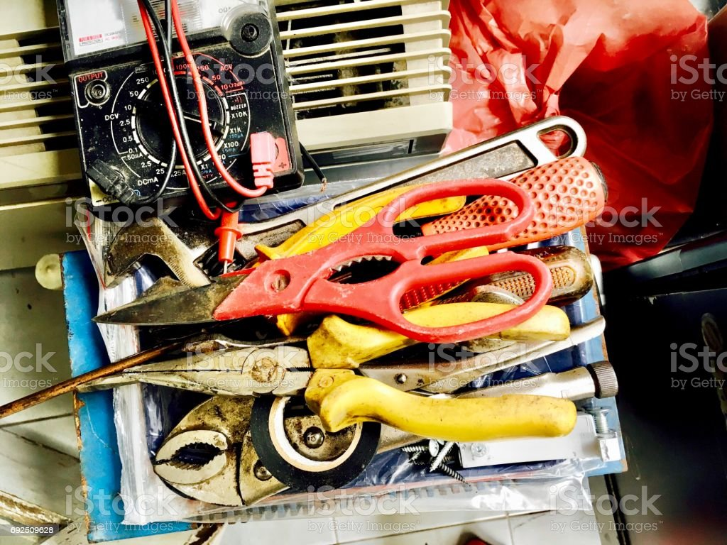 Used Wrench, Pliers, Scissors and Electrical Tester stock photo