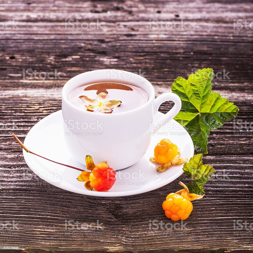 Useful light breakfast snack. Fresh herbal fruit tea with berries stock photo