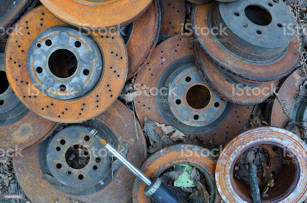 Useless, old rusty brake discs stock photo