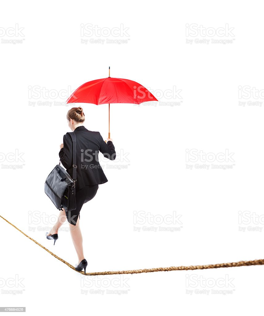 usiness Woman Balancing Worklife Tightrope on White Background stock photo
