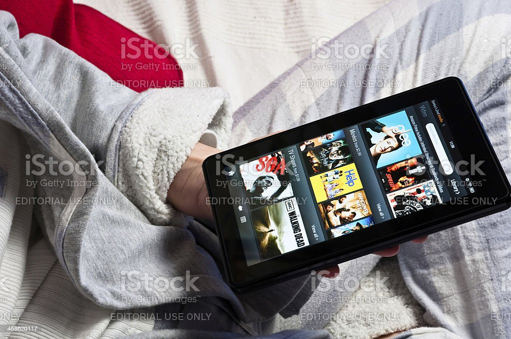 Using a Amazon Kindle Fire tablet stock photo