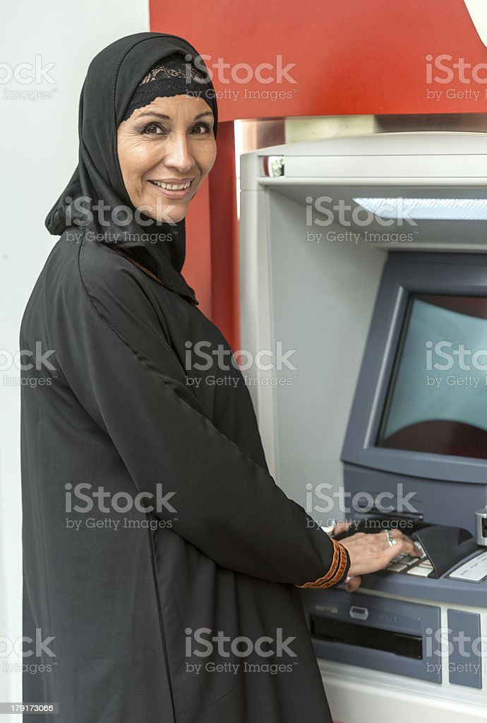 Using a bank ATM stock photo