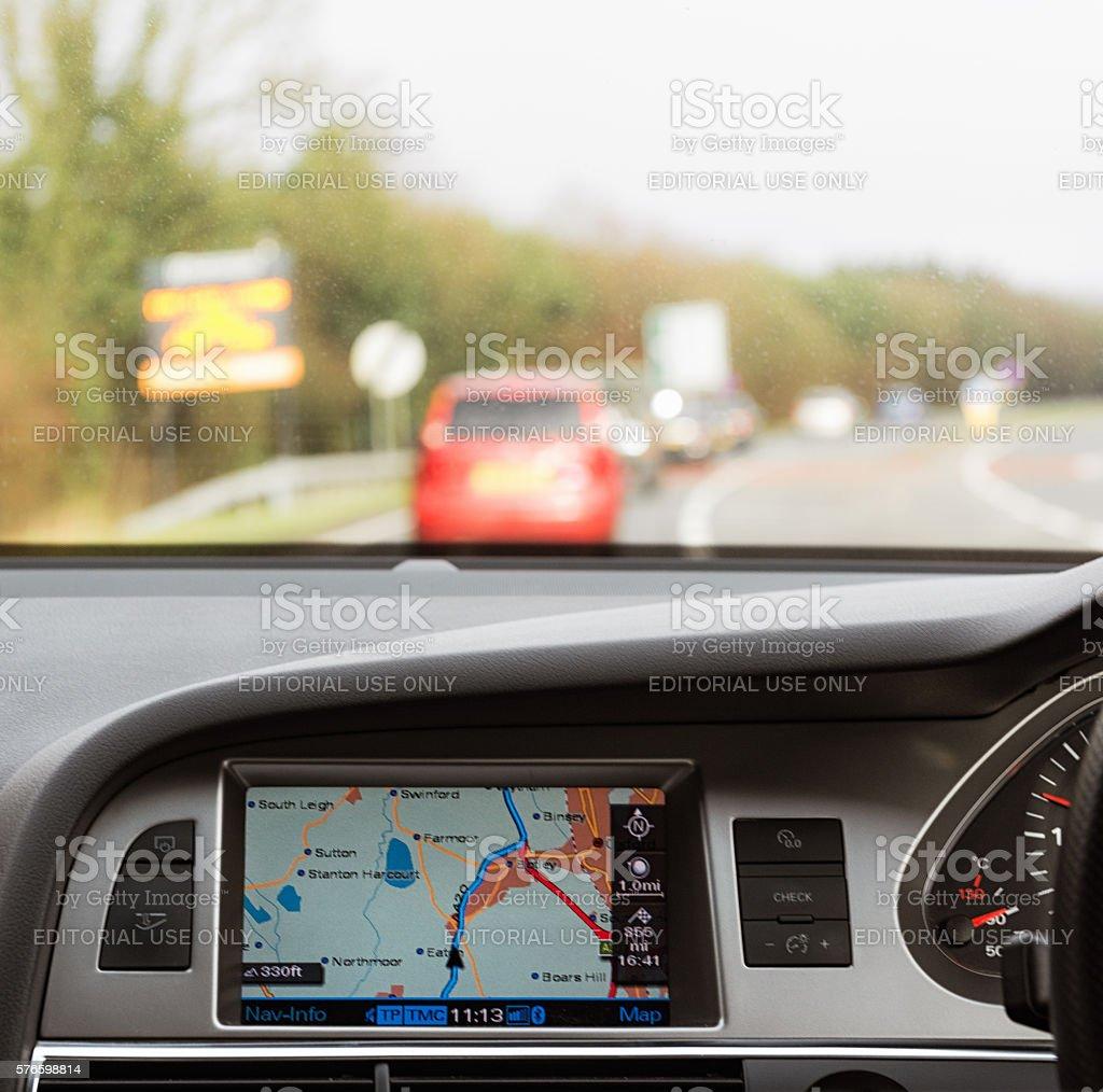 Using a built-in car satnav on a British trunk road stock photo