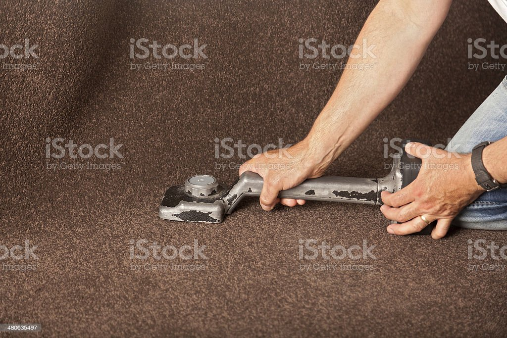 Using a carpet stretcher stock photo